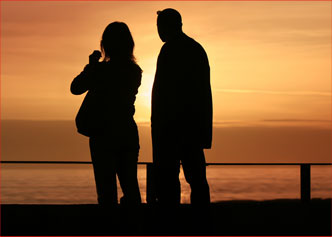 Image of A Couple In Silhouette Against The Sunset Looking For Resources